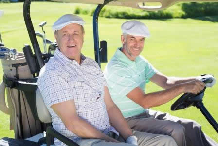 men in golf buggy